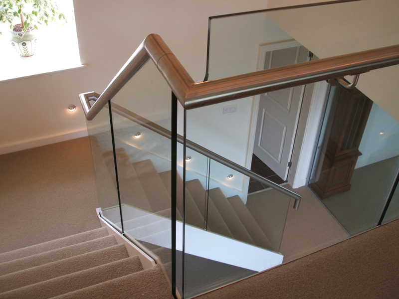 What is the difference between handrails and balustrades?